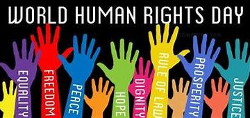 Many multicolored hands - red, blue, green, purple, yellow - reaching up to a black sky. Aspirations such as equality, freedom, and prosperity are written in white on each arm. White test at the top says World Human Rights Day.